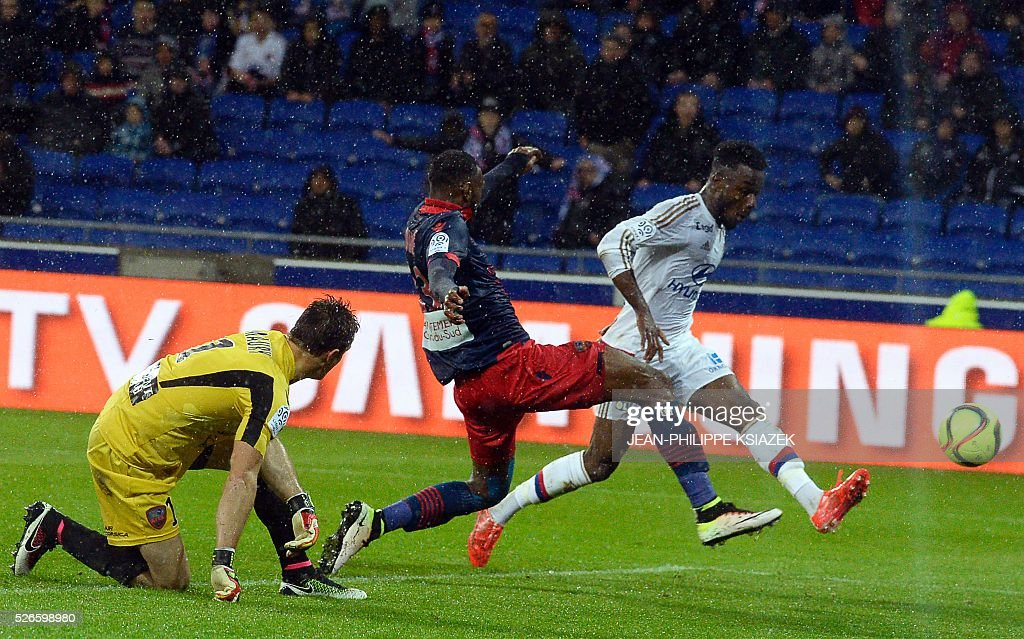 Lyon's French forward Maxwel Cornet (R) scores a goal during the French L1 football match Lyon (OL) vs Ajaccio (GFCA) at the Parc Olympique Lyonnais stadium in Decines-Charpieu, central eastern France, on April 30, 2016.