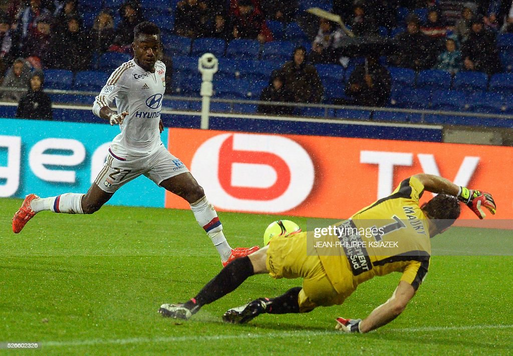 Lyon's French forward Maxwel Cornet (L) scores a goal during the French L1 football match Lyon (OL) vs Ajaccio (GFCA) at the Parc Olympique Lyonnais stadium in Decines-Charpieu, central eastern France, on April 30, 2016.
