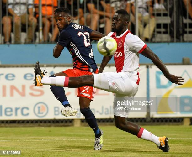 Lyon's French forward Maxwel Cornet vies with Ajax defender Davinson Sanchez during a friendly football match between Olympique Lyonnais and Ajax...