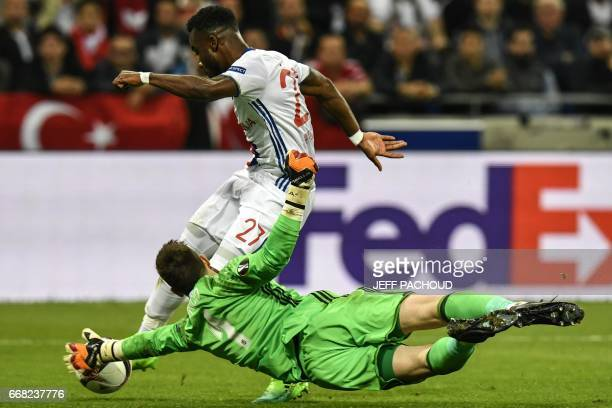 Lyon's French forward Maxwel Cornet vies with Besiktas' Spanish goalkeeper Fabricio Agosto Ramirez during the UEFA Europa League first leg quarter...