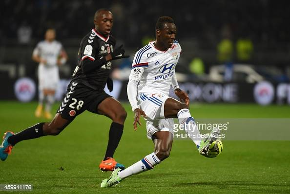 Lyon's French forward Mohamed Yattara vies for the ball with Reims' French defender Antoine Conte during the French League football match Olympique...