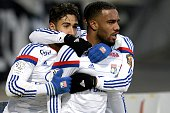 Lyon's French forward Nabil Fekir and Lyon's French forward Alexandre Lacazette celebrates after scoring a goal during the French L1 football match...