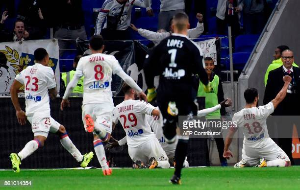 Lyon's French forward Nabil Fekir celebrates with teammates after scoring a goal during the French L1 football match between Lyon and Monaco on...