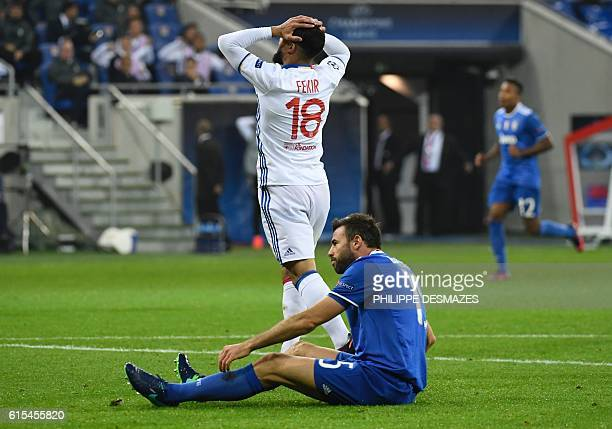Lyon's French forward Nabil Fekir reacts next to Juventus' Italian defender Andrea Barzagli during the Champions League football match between...