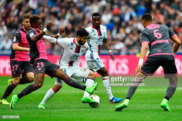 Lyon's French forward Nabil Fekir vies with Toulouse's Swiss defender Jacques François Moubandje during the French L1 football match between...
