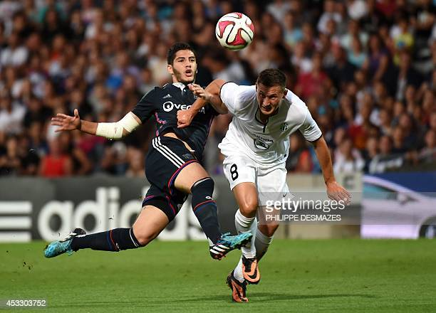 Lyon's French forward Yassine Benzia challenges Mlada Boleslav's Czech defender Jan Boril during the UEFA Europa League third qualifying round...