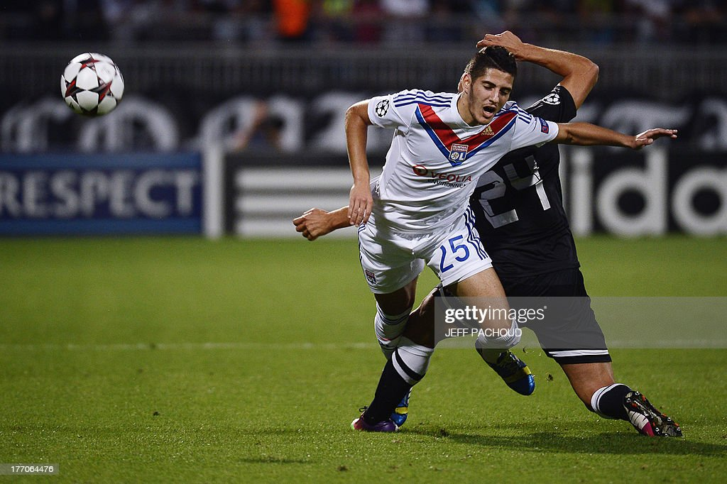 Lyon's French forward Yassine Benzia (L) is tackled by Real Sociedad's Spanish defender Alberto De La Bella (R) during the first leg of the UEFA Champions League's playoffs football match Olympique Lyonnais vs Real Sociedad on August 20, 2013 at the Gerland stadium in Lyon, eastern France. AFP PHOTO / JEFF PACHOUD