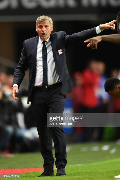 Lyon's French head coach Bruno Genesio reacts during the French L1 football match between Stade Rennais and Olympique Lyonnais on August 11 at the...