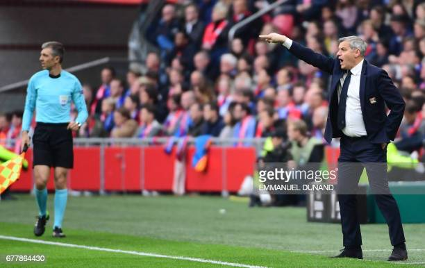 Lyon's French head coach Bruno Genesio reacts during UEFA Europa League semifinal first leg Ajax Amsterdam v Olympique Lyonnais on May 3 2017 in...