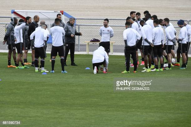 Lyon's French head coach Bruno Genesio speaks to his players during a training session at Parc Olympique Lyonnais Stadium in DecinesCharpieu on May...
