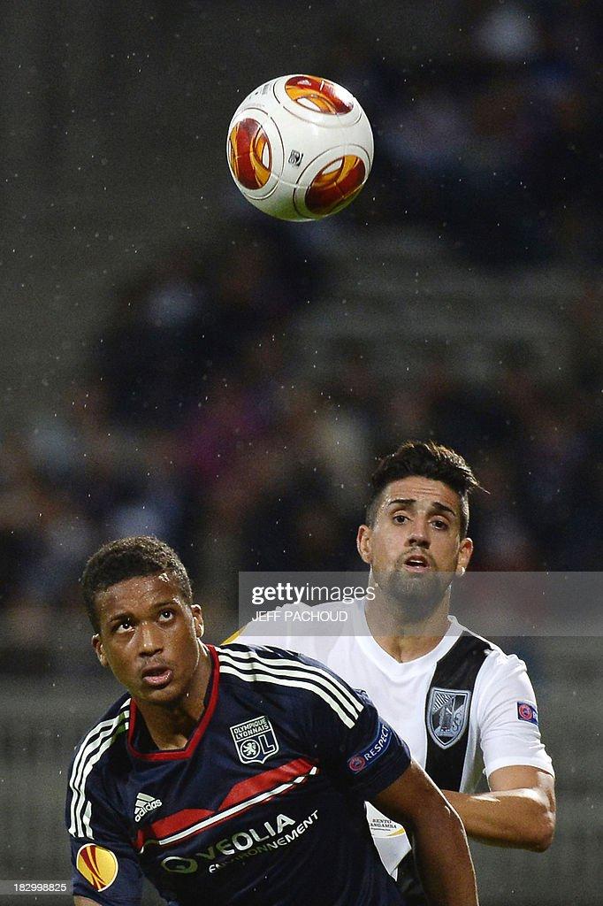 Lyon's French midfielder Alassane Plea (L) eyes the ball with Vitoria Guimaraes' Portuguese forward (R) during the UEFA Europa League group I football match Olympique Lyonnais (OL) vs Vitoria Guimaraes on October 3, 2013, at the Gerland Stadium in Lyon, central-eastern France.