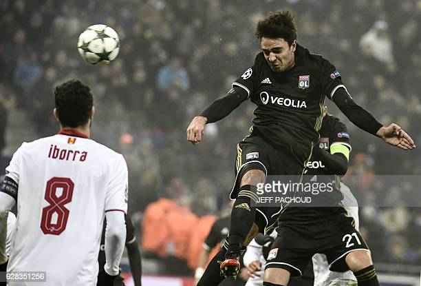 Lyon's French midfielder Clement Grenier heads the ball during the UEFA Champions League Group H football match between Olympique Lyonnais and FC...
