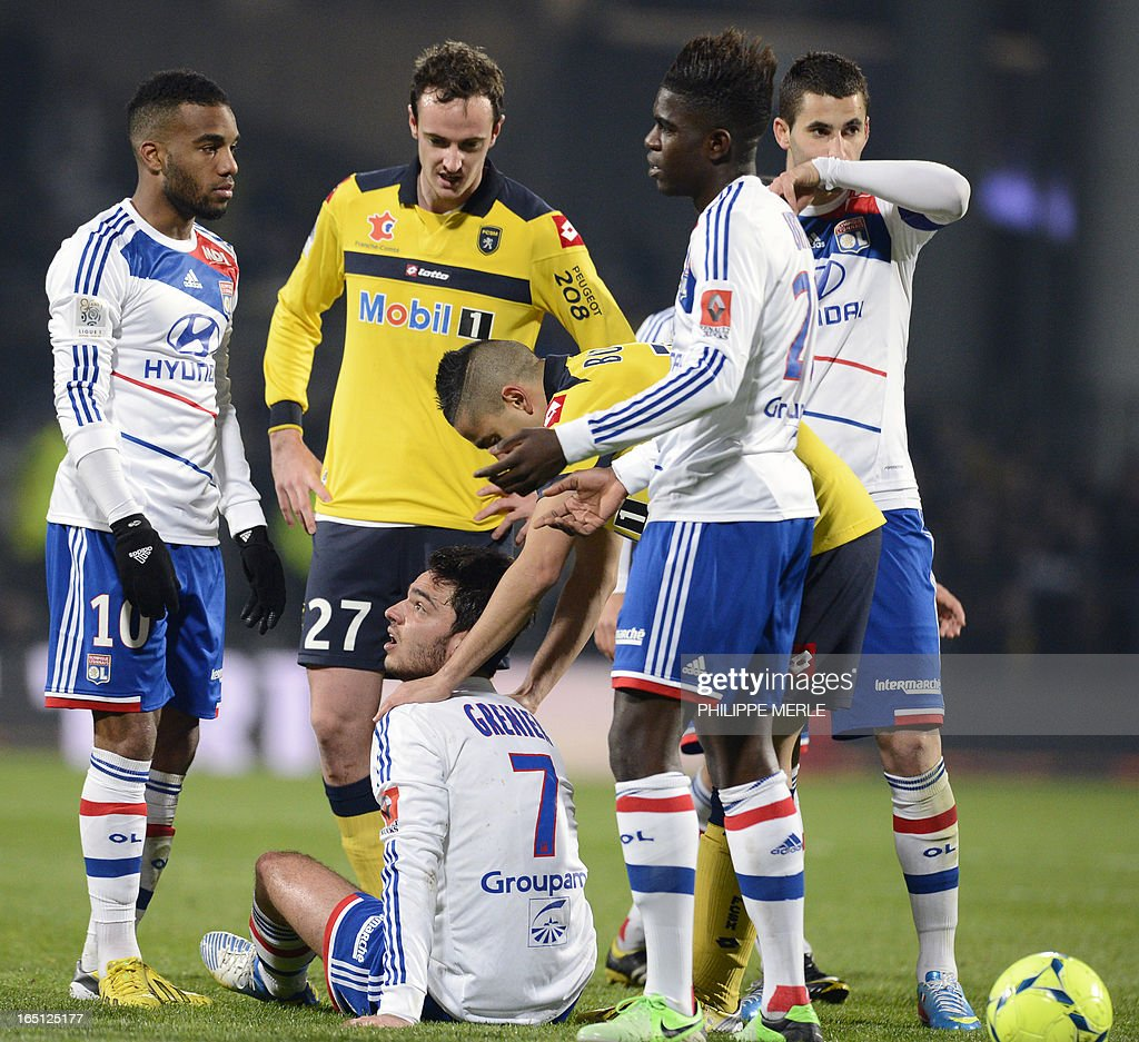 Lyon's French midfielder Clement Grenier (C) reacts with teammates during the French L1 football match Lyon vs Sochaux on March 31, 2013 at the Gerland stadium in Lyon.
