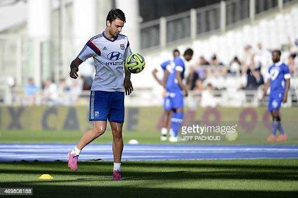 Lyon's French midfielder Clement Grenier warms up prior to the French L1 football match Olympique Lyonnais vs SC Bastia on April 15 at the Gerland...