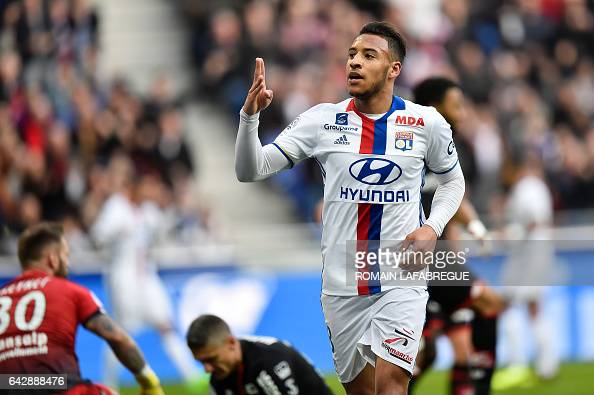 Lyon's French midfielder Corentin Tolisso celebrates after scoring a goal during the French L1 football match between Olympique Lyonnais and Dijon on...