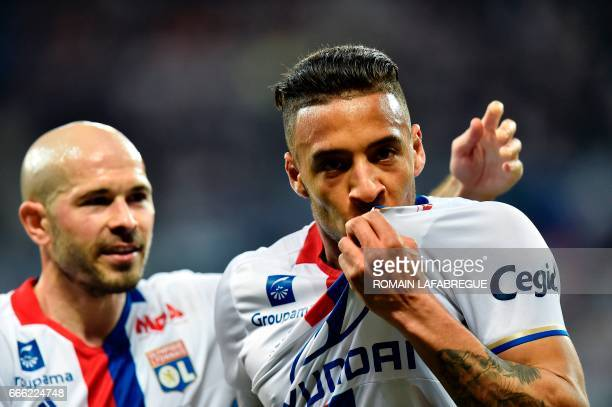 Lyon's French midfielder Corentin Tolisso celebrates after scoring a goal with Lyon's French defender Christophe Jallet during the French L1 football...