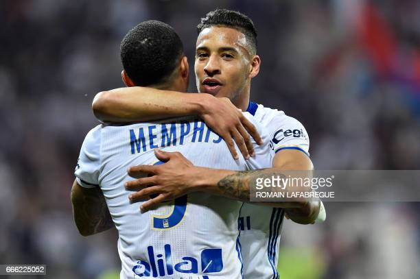 Lyon's French midfielder Corentin Tolisso celebrates after scoring a goal with Lyon's Dutch forward Memphis Depay during the French L1 football match...
