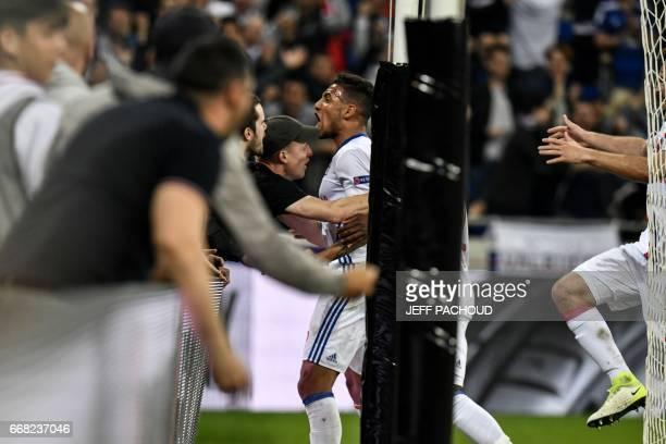 Lyon's French midfielder Corentin Tolisso celebrates after scoring a goal during the UEFA Europa League first leg quarter final football match...