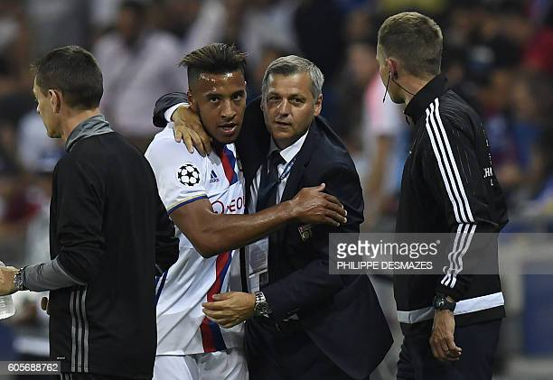 Lyon's French midfielder Corentin Tolisso celebrates with Lyon's head coach Bruno Genesio after scoring during the Champions League Group H football...