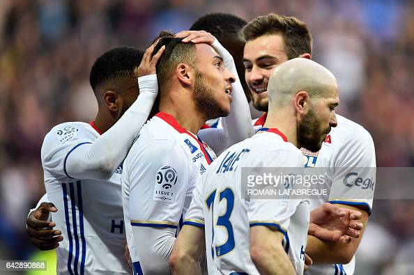 Lyon's French midfielder Corentin Tolisso celebrates with teammates after scoring a goal during the French L1 football match between Olympique...