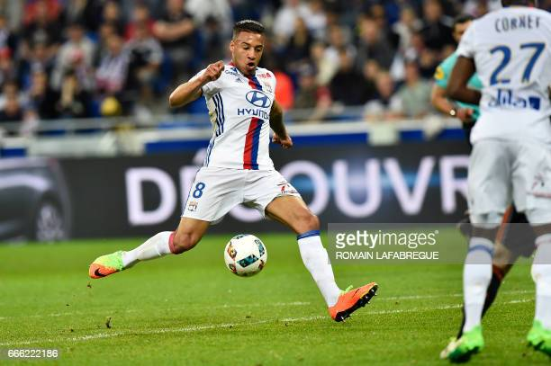 Lyon's French midfielder Corentin Tolisso kicks the ball and scores during the French L1 football match between Olympique Lyonnais and Lorient on...