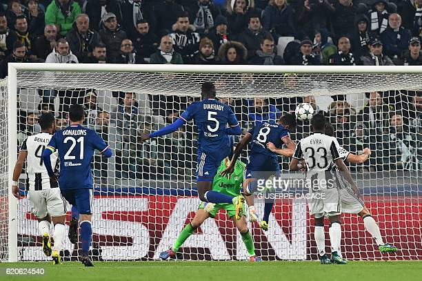 Lyon's French midfielder Corentin Tolisso scores during the UEFA Champions League football match Juventus vs Olympique Lyonnais on November 2 2016 at...