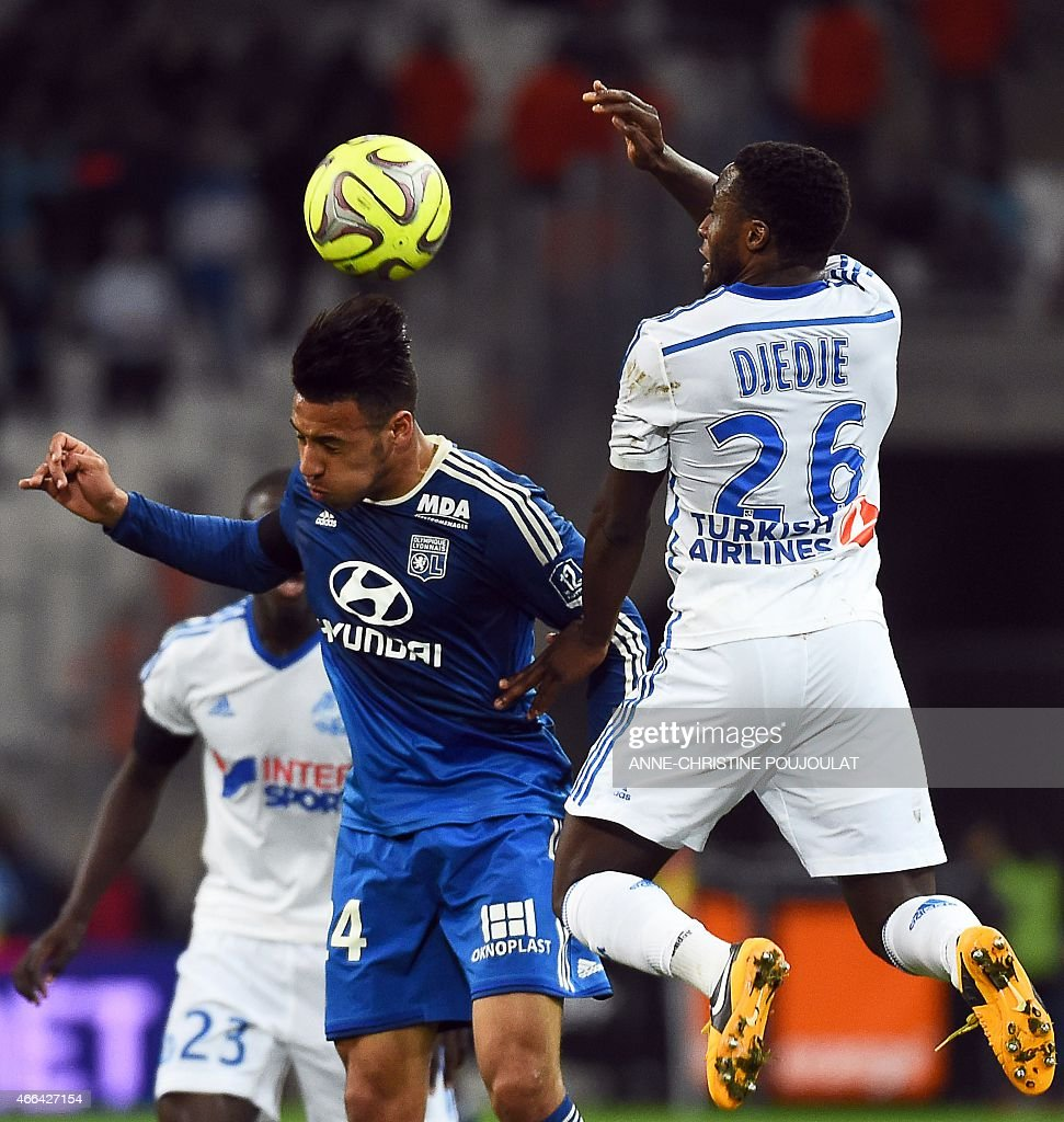 Lyon's French midfielder Corentin Tolisso (L) vies with Marseille's Ivoirian defender Brice Dja Djedje (R) during the French L1 football match between Marseille and Lyon, on March 15, 2015 at the Velodrome stadium in Marseille, southern France.