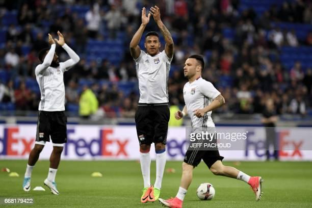 Lyon's French midfielder Coretin Tolisso and Lyon's French forward Mathieu Valbuena warm up prior to the UEFA Europa League first leg quarter final...