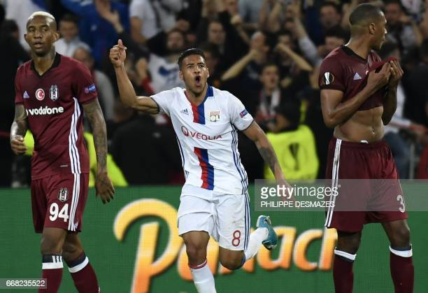 Lyon's French midfielder Coretin Tolisso reacts after scoring a goal during the UEFA Europa League first leg quarter final football match between...