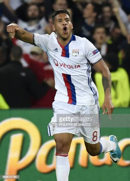 Lyon's French midfielder Coretin Tolisso reacts after scoring during the UEFA Europa League first leg quarter final football match between Lyon and...