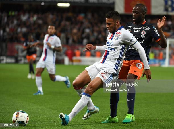 Lyon's French midfielder Coretin Tolisso vies with Montpellier's French forward Jonathan Ikone during the French L1 football match between...
