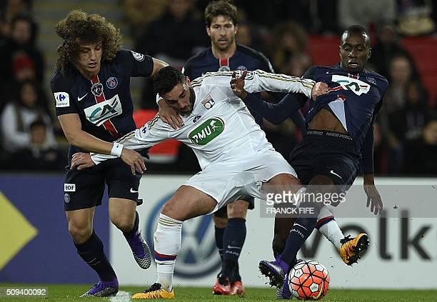 TOPSHOT Lyon's French midfielder Coretin Tolisso vies with Paris SaintGermain's Brazilian defender David Luiz and Paris SaintGermain's French...