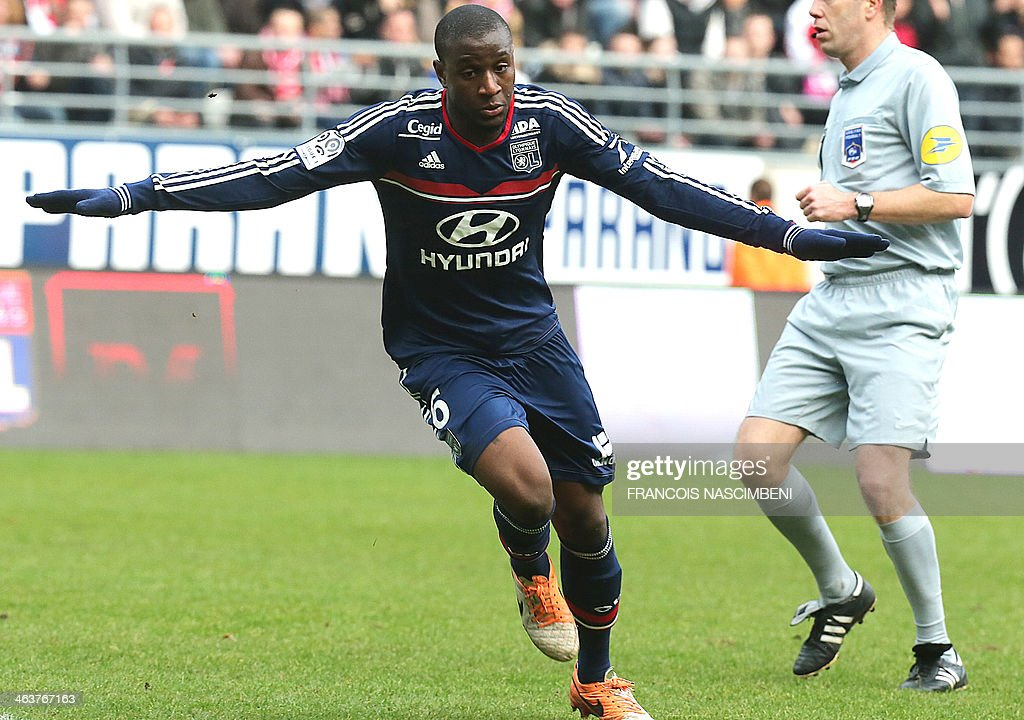 Lyon's French midfielder Gueida Fofana celebrates after scoring a goal during a French L1 Football match between Reims and Lyon on January 19, 2014 at the Auguste Delaune Stadium in Reims.