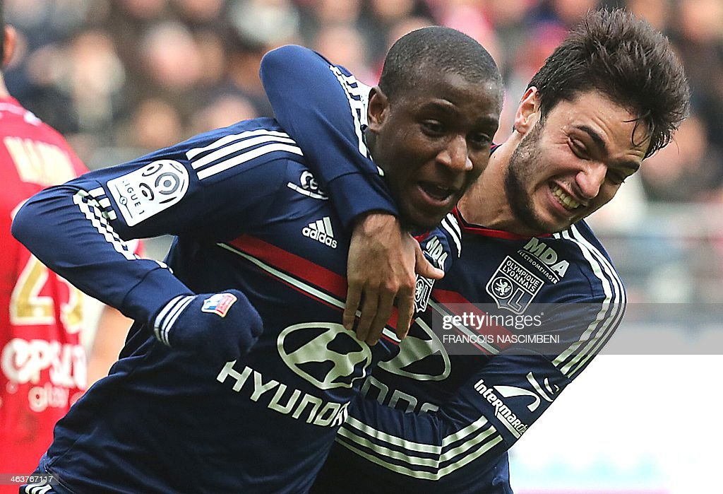 Lyon's French midfielder Gueida Fofana (L) celebrates with French midfielder Clement Grenier after he scored a goal during a French L1 Football match between Reims and Lyon on January 19, 2014 at the Auguste Delaune Stadium in Reims.