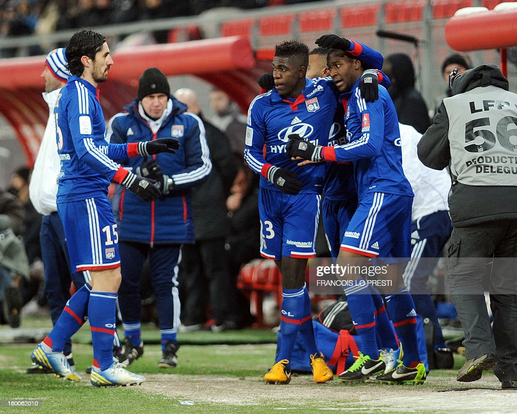 Lyon's French midfielder Gueida Fofana (R) celebrates with teammates after scoring during the French L1 football match Valenciennes vs Olympique lyonnais at the stadium 'stade du hainaut' in Valenciennes on January 25, 2013.