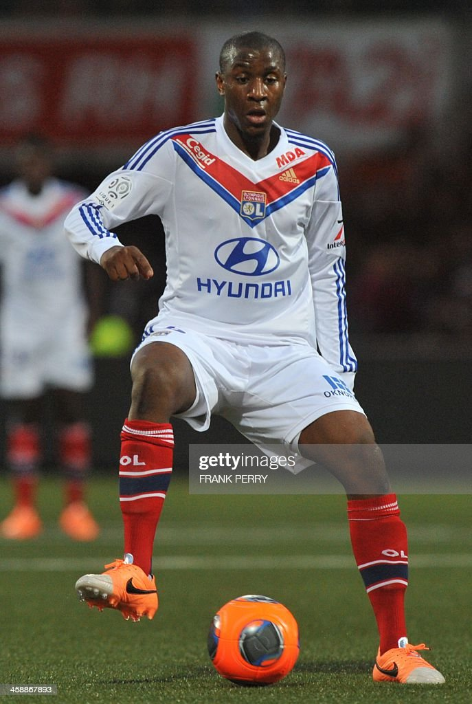 Lyon's French midfielder <a gi-track='captionPersonalityLinkClicked' href=/galleries/search?phrase=Gueida+Fofana&family=editorial&specificpeople=4309091 ng-click='$event.stopPropagation()'>Gueida Fofana</a> runs with the ball during the French L1 football match between Lorient and Lyon on December 22, 2013, at Le Moustoir stadium in Lorient, western France.
