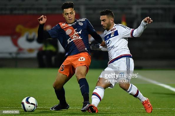 Lyon's French midfielder Jordan Ferri challenges Montpellier's Algerian defender Ramy Bensebaini during the French L1 football match between Lyon and...