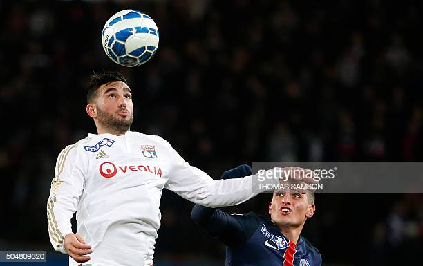 Lyon's French midfielder Jordan Ferri heads the ball next to Paris SaintGermain's Italian midfielder Marco Verratti during the French League Cup...