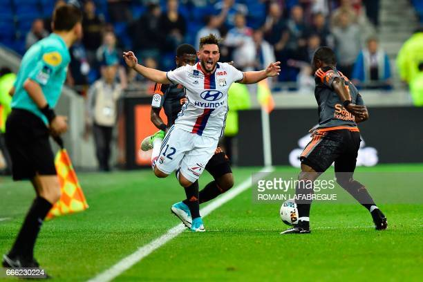 Lyon's French midfielder Jordan Ferri is tackled by Lorients French midflielder Arnold Mvuemba during the French L1 football match between Olympique...
