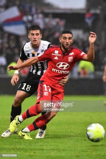 Lyon's French midfielder Jordan Ferri vies with Angers' French midfielder Baptiste Santamaria during the French L1 football match between Angers and...