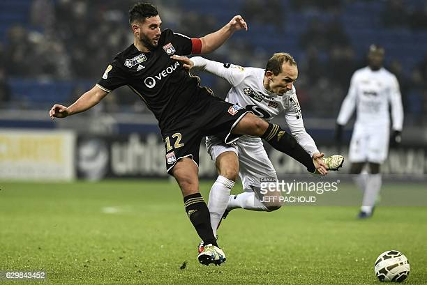 Lyon's French midfielder Jordan Ferri vies with Guingamp's French midfielder Thibault Giresse during the French League Cup football match between...
