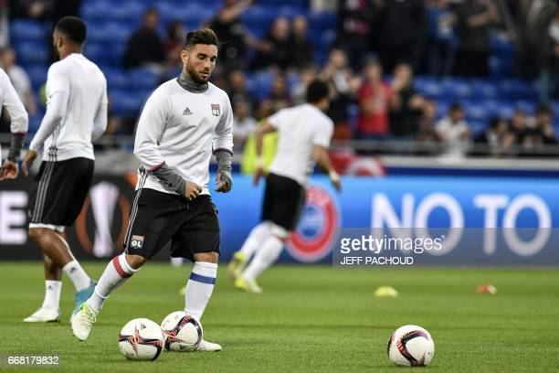 Lyon's French midfielder Jordan Ferri warms up prior to the UEFA Europa League first leg quarter final football match between Lyon and Besiktas on...