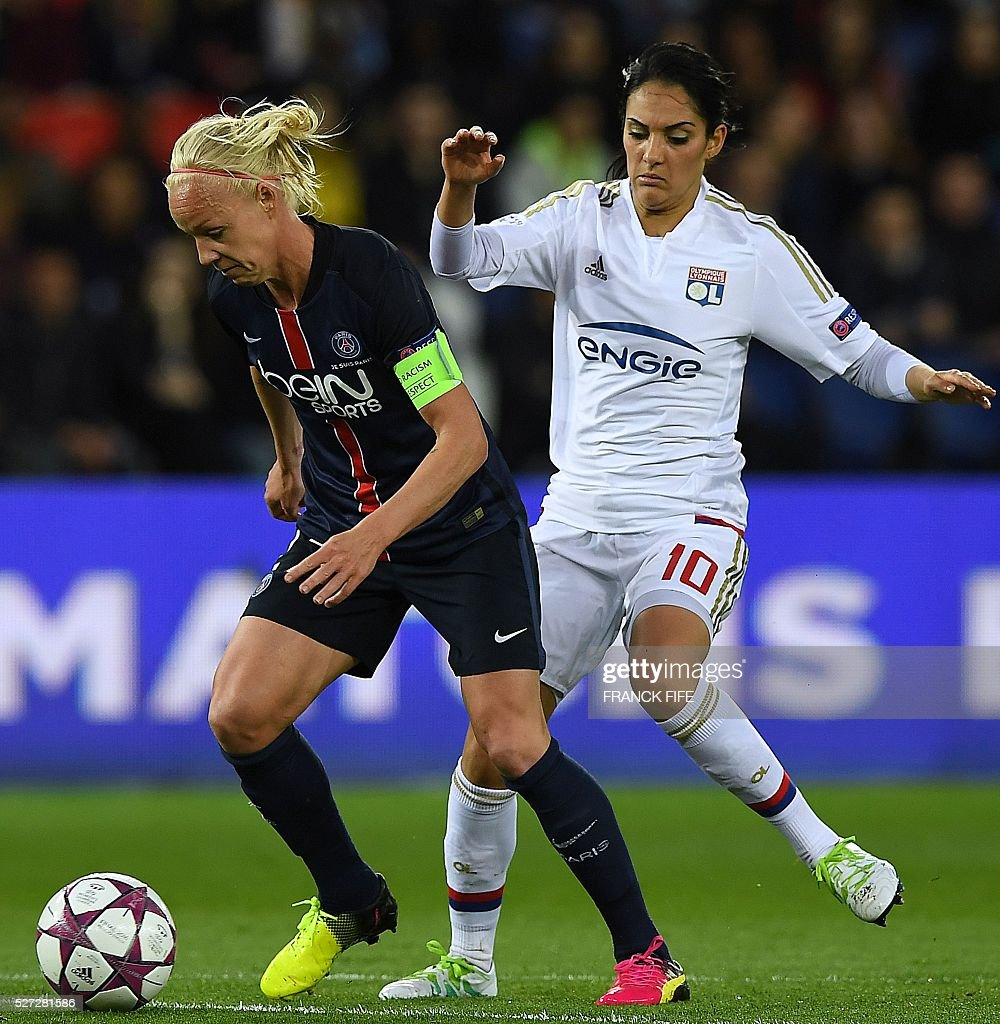 Lyon's French midfielder Louisa Necib (R) vies with Paris Saint-Germain's Swedish midfielder Caroline Seger during the UEFA Women's Champions League semi-final second leg football match between Paris Saint-Germain (PSG) and Lyon at the Parc des Princes stadium in Paris on May 2, 2016. / AFP / FRANCK