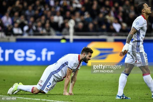 Lyon's French midfielder Lucas Tousart and Lyon's Dutch forward Memphis Depay react during the French L1 football match Olympique Lyonnais vs AS...