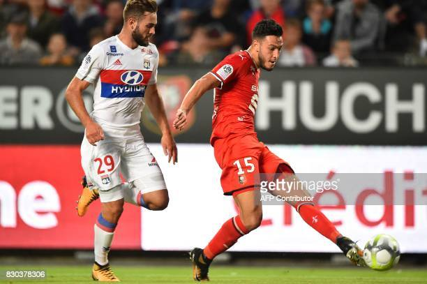 Lyon's French midfielder Lucas Tousart vies for the ball with Rennes' Algerian defender Rami Amir Selmane Bensebaini during the French L1 football...