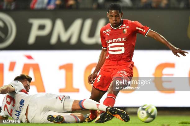 Lyon's French midfielder Lucas Tousart vies for the ball with Rennes' French defender Ludovic Baal during the French L1 football match between Rennes...