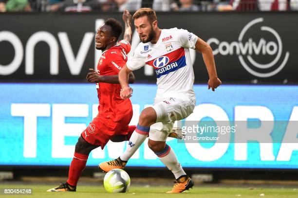 Lyon's French midfielder Lucas Tousart vies for the ball with Rennes' Mozambican defender Mexer during the French L1 football match between Stade...