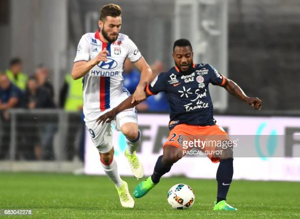 Lyon's French midfielder Lucas Tousart vies with Montpellier's French midfielder Stephane Sessegnon during the French L1 football match between...