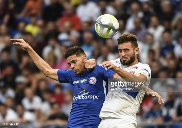 Lyon's French midfielder Lucas Tousart vies with Strasbourg's French forward Jonas Martin during the Ligue1 football match Olympique Lyonnais against...