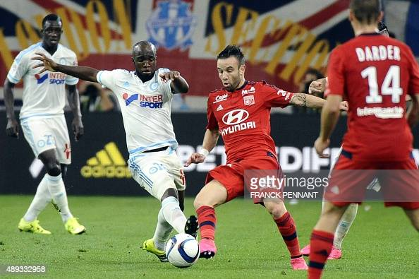 Lyon's French midfielder Mathieu Valbuena vies with Marseille's French midfielder Lassana Diarra during the French L1 football match Marseille vs...